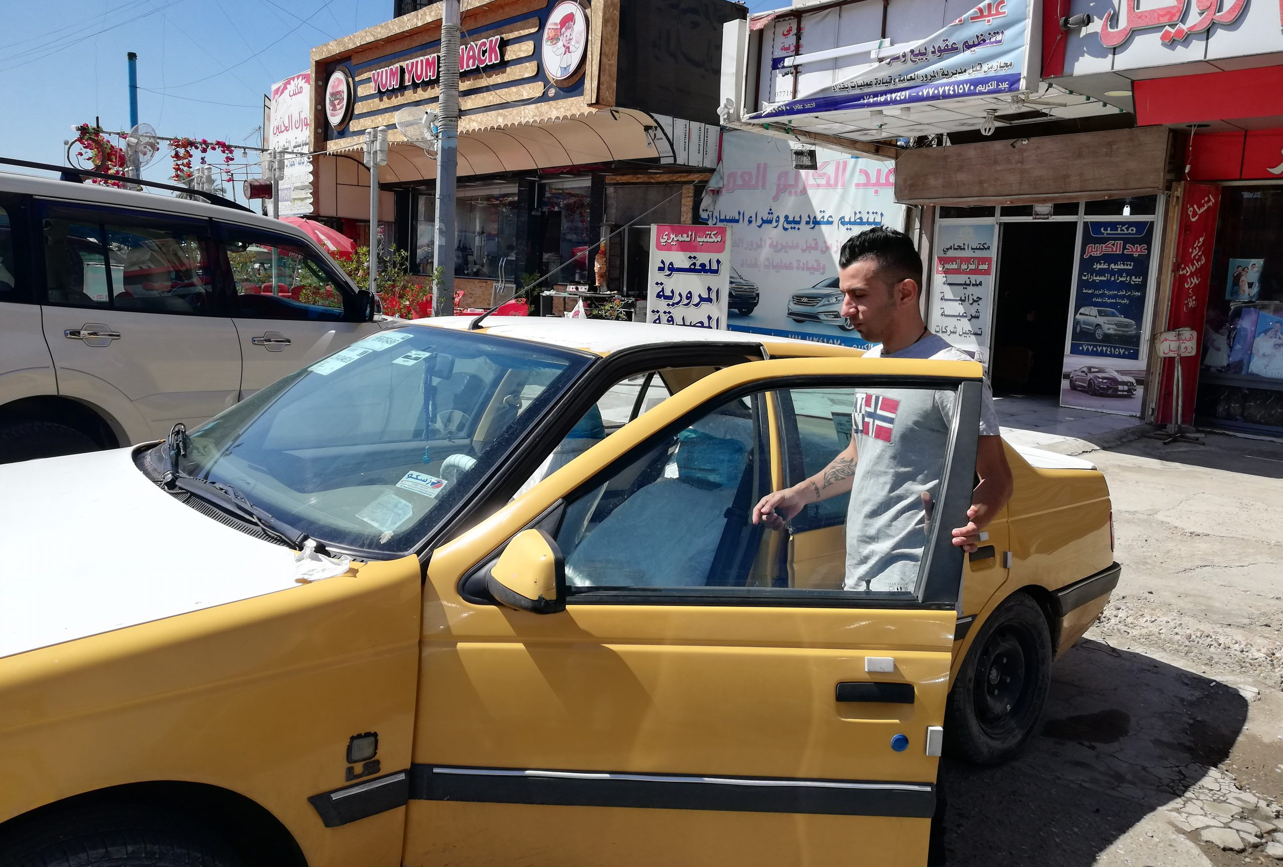 A man with a taxi in Baghdad.