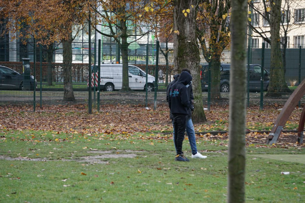 Migrants standing in Parc Maximilien in Brussels