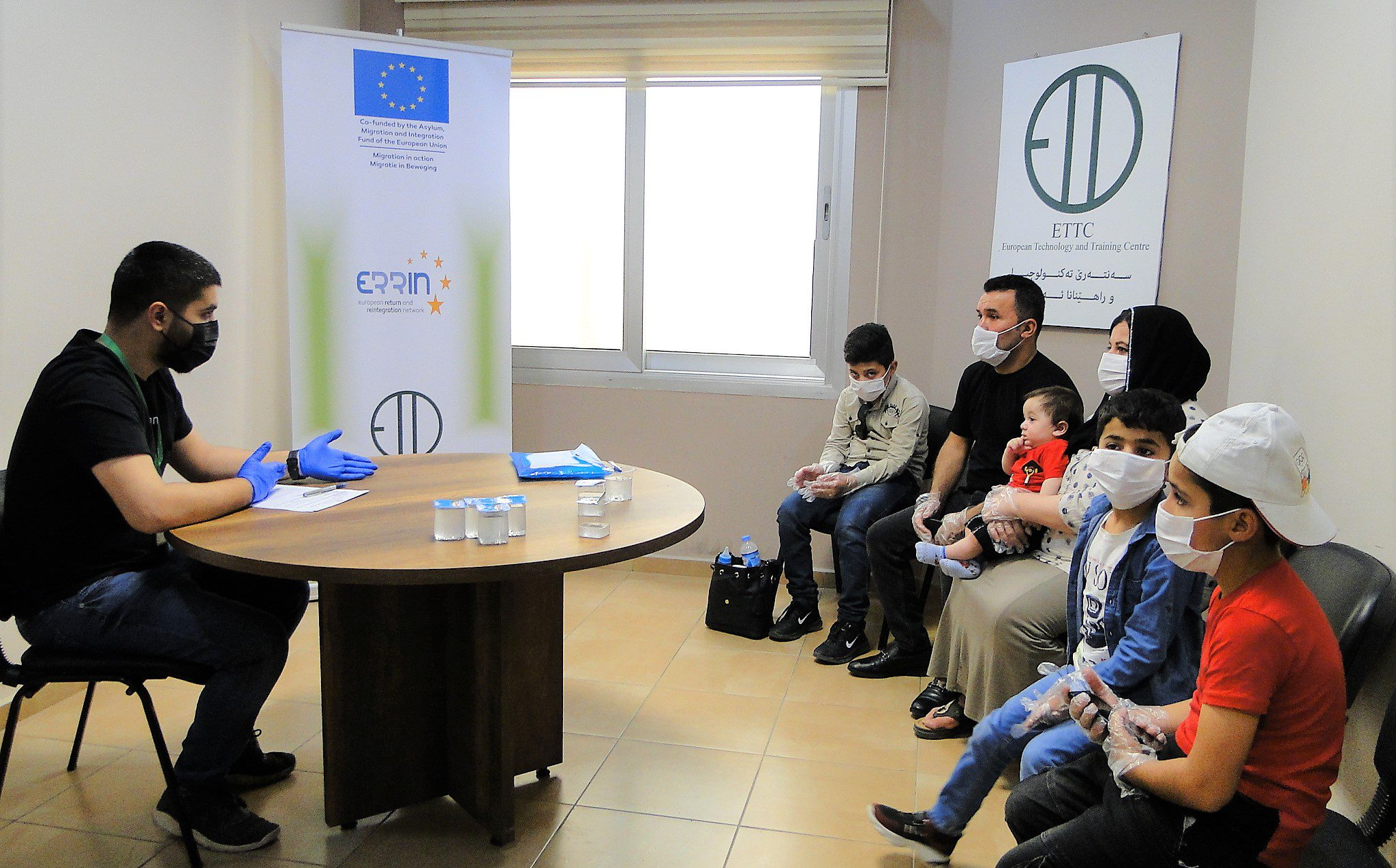 Beneficiary with his family at the ETTC office in Kurdistan.