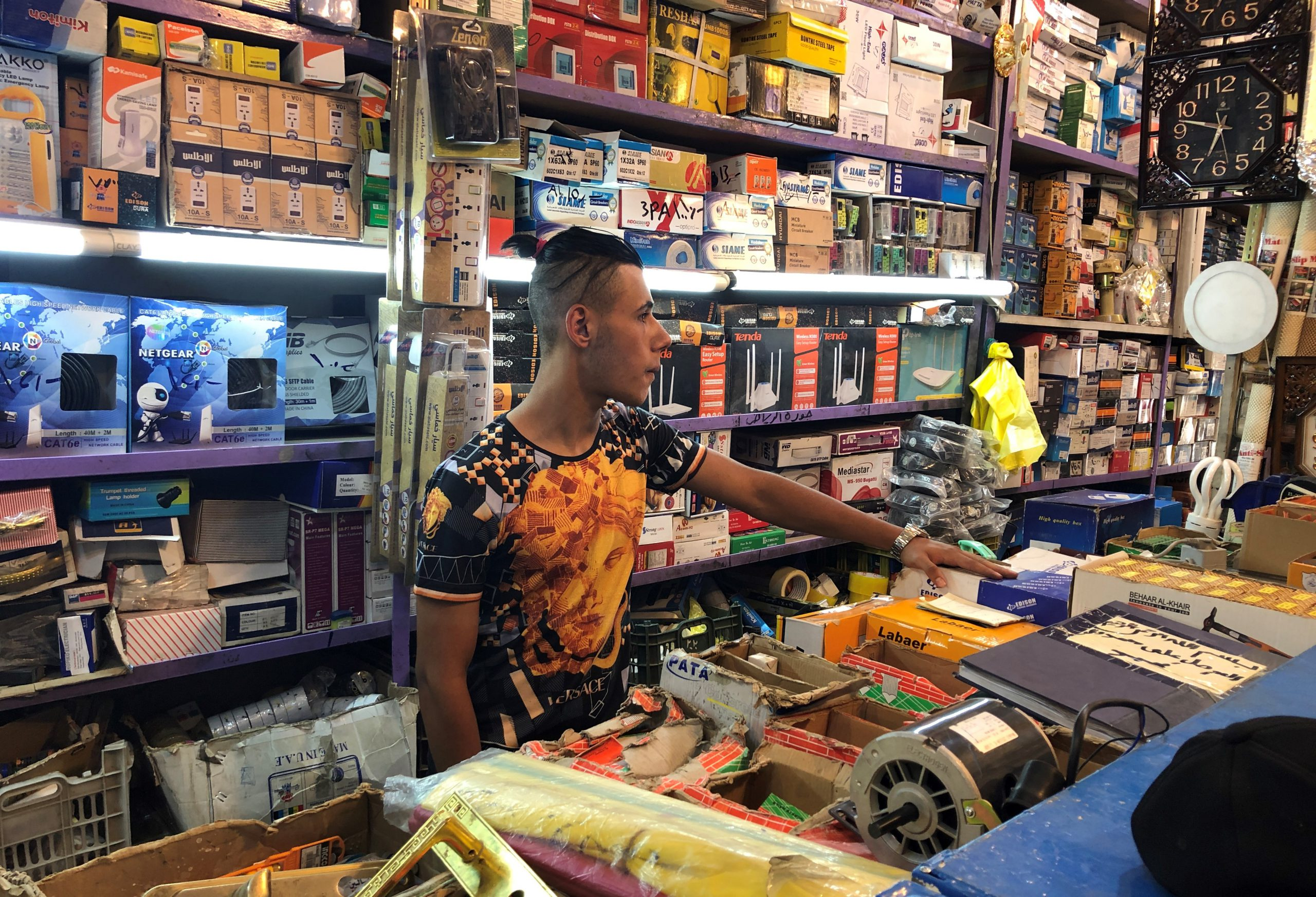 A man in a store with electronic spare parts, Baghdad.
