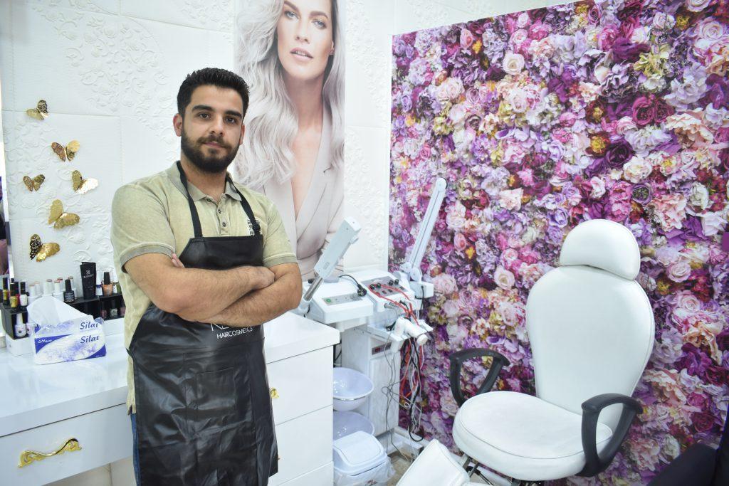 A man standing in a beauty salon in Kurdistan.