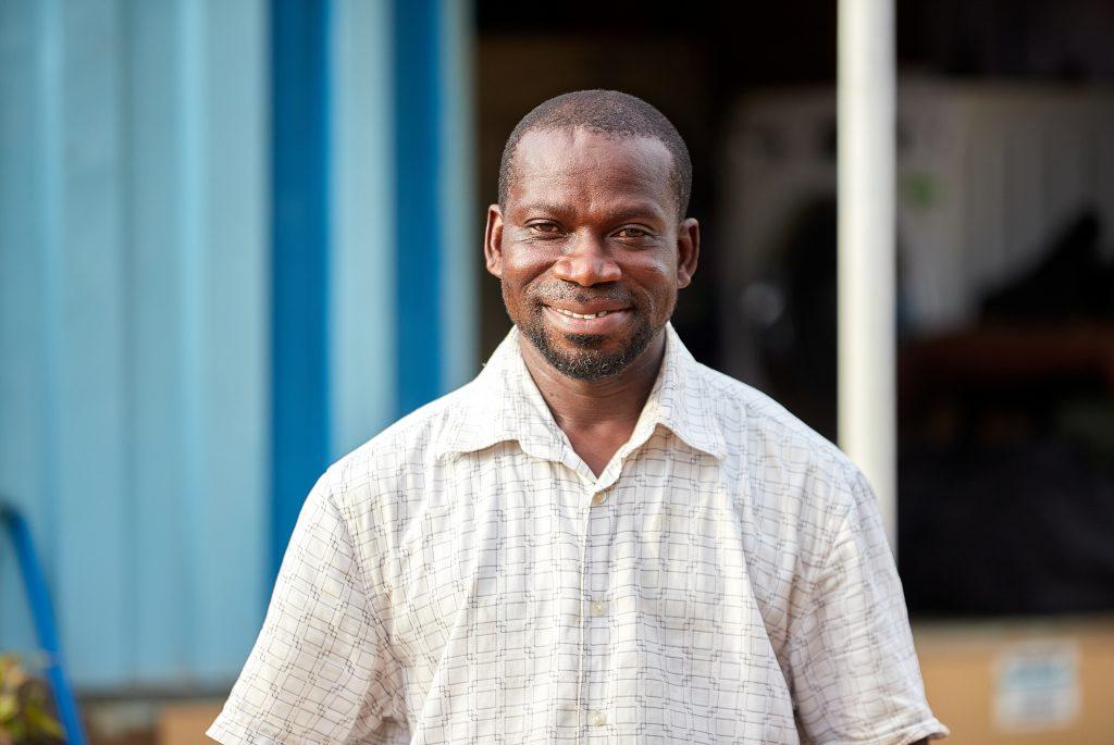 A smiling man's portrait.