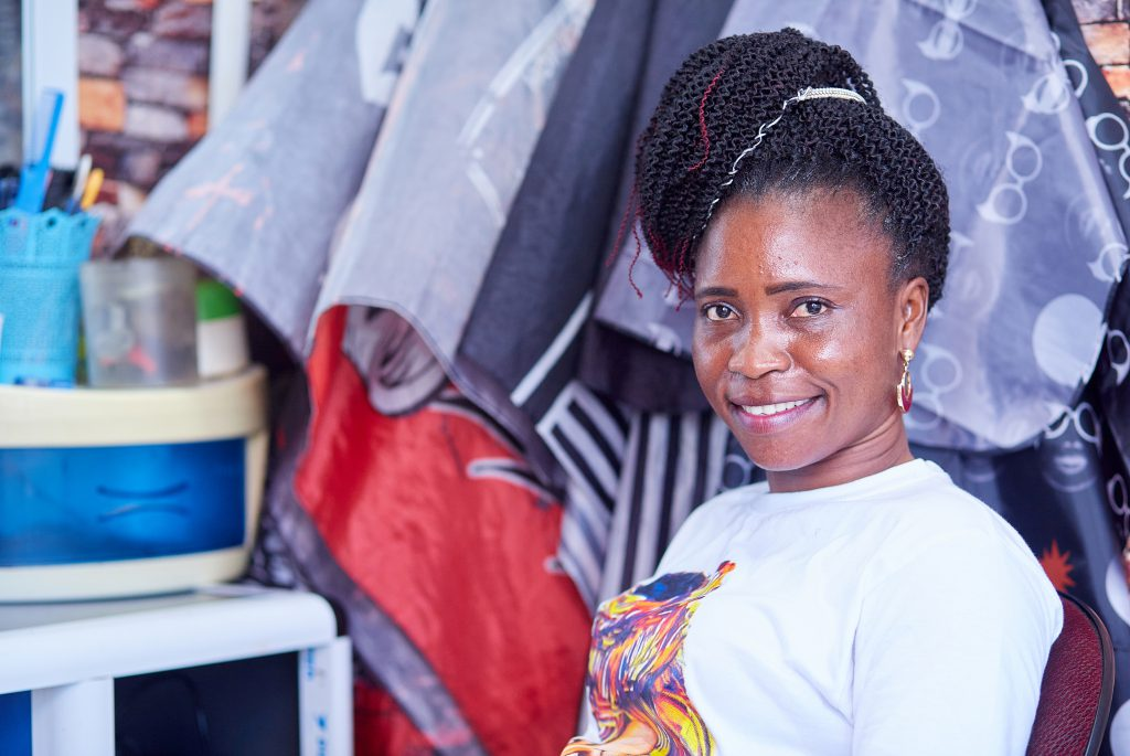 A smiling Ghanaian woman's portrait.